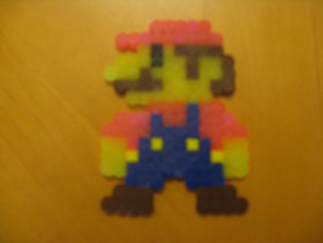 Mario. Lol he looks like his liver failed ._.